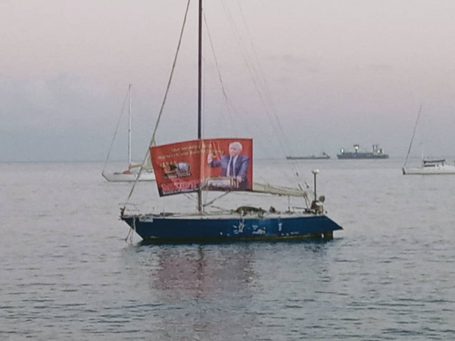 A banner protesting the Australia Government in support of Witness K and Bernard Collaery unfolded on a yacht  in front of the Palacio do Governo