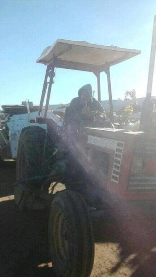 A Timorese worker is doing his work in a garden in Australia