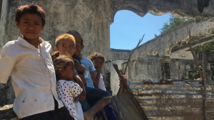 East Timorese Children and the old house were burnt by pri Indonesian Militia in 1999 which not yet rehabilitate